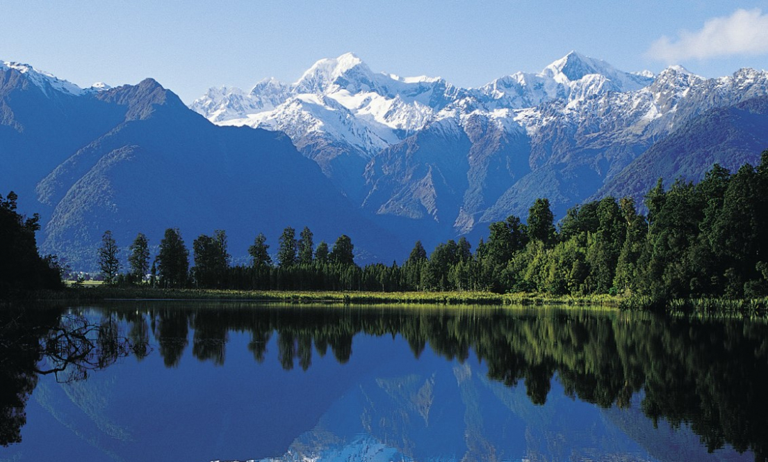 New Zealand mountains overlooking a pristine valley lake