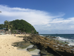 A sunny beach in the Philippines on a windy day