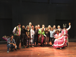 CHID Peru students and faculty on a stage with the Yuyachkani Cultural Group
