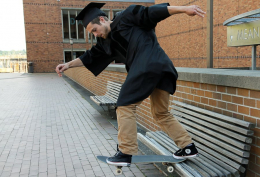 Peter Starrs skateboating in cap and gown