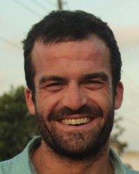 Willy Oppenheim's profile photo. Close head shot of Willy smiling, in a blue button-up shirt.