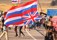 Girl waving large flag, symbolizing Hawaiian resistance to colonialism