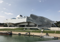 Boats in the water in front of the Muse des Confluences in Lyon, France