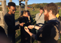 Nat Mengist and students sampling foods at Finn River Orchard