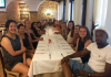 Students at dinner table in Sardinia