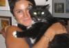 Maria Elena Garcia with cat