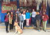 CHID study abroad program students and program directors in front of a store in Peru